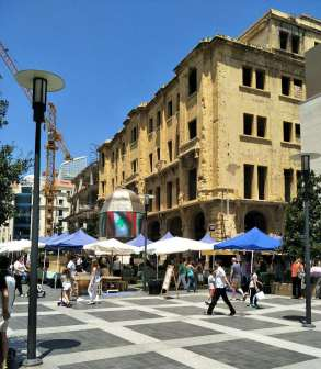 Souk el Tayeb Saturday farmers market. Not the state the building behind the tents.