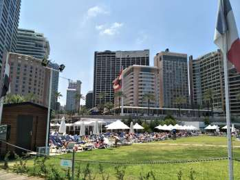 In the shadow of three war hotels is a pool and bayfront yacht club where the upper-class lounge and relax in the sun.